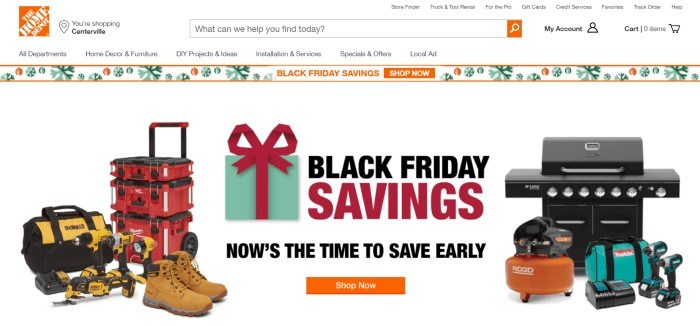 This screenshot of the home page for the Home Depot has a white header and background with the orange logo, a black Friday savings advertisement bar with green snowflakes, and a large advertisement section with text in black and red announcing Black Friday savings, along with several images of Home Depot products including tools and a grill.