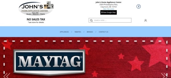 This screenshot of the home page for John's Home Appliance Center has a large white header with a gray, black, and tan logo above a light blue navigation bar and a large red section with lighter red stars and a large Maytag logo in black and silver.