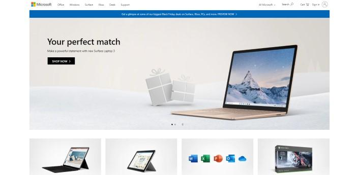 """This screenshot of the home page for Microsoft has a white background and navigation bar above a blue announcement for previewing Black Friday deals and an image of an open Surface laptop on what appears to be snowy ground beneath a gray sky, with black words reading """"Your perfect match"""" and a black call-to-action button."""