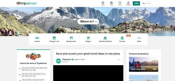 This screenshot of the home page for TripAdvisor shows groups of what appear to be tourists on a rugged mountain ridge, behind a white text box reading