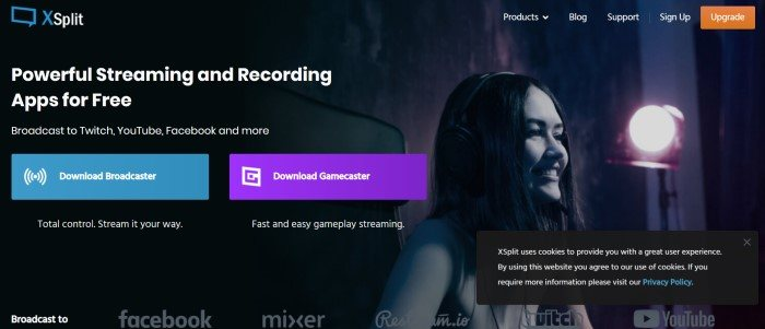 This screenshot of the home page for Xsplit has a black background with a dark filtered photo f a smiling woman who appears to be streaming a game she's playing, along with white text announcing powerful streaming and recording apps and call-to-action buttons in blue and purple.