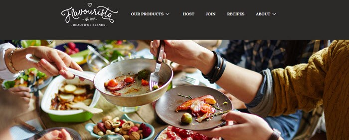 Flavourista Website Screenshot showing people and food around a table