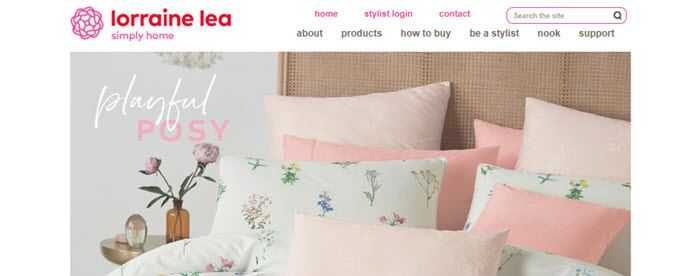 Lorraine Lea Website Screenshot showing a bed with pretty linen
