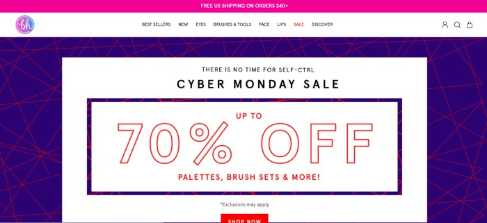 This screenshot of the home page for BH Cosmetics has a pink header announcing free shipping, a white navigation bar, a dark blue background with crossing red lines, and a white main section with black and red text announcing a 70% off sale for Cyber Monday.