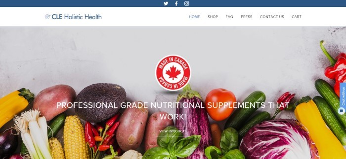 """This screenshot of the home page for CLE Holistic Health has a white and blue navigation bar above a large overhead photo of several fruits and vegetables lying on a white background, along with a """"Made in Canada"""" seal in red and white and white lettering announcing professional-grade nutritional supplements."""