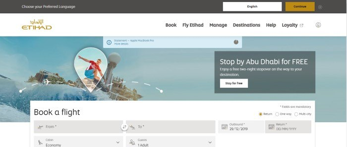 This screenshot of the home page for Etihad Airways has a black header with a window for choosing a preferred language, a white navigation bar, and a photo of a young man in a red shirt and blue shorts waterboarding with a waterpark in the background, along with an invitation to stop by Abu Dhabi and a large search window for booking a flight.