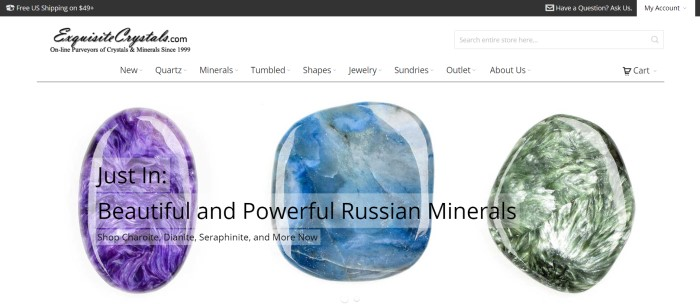 This screenshot of the home page for Exquisite Crystals has a dark header announcing free shipping, a white background, and three large photo of individual stones in purple, blue, and green, behind an announcement of new arrivals of Russian minerals.