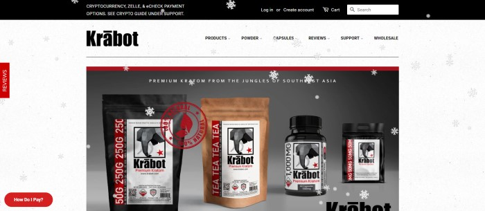 This screenshot of the home page of Krabot has a white background with gray snowflakes, a black header announcing the ability to pay with cryptocurrency, and a photo with a gray background showing sample packages of Kratom products in black, white, and brown.