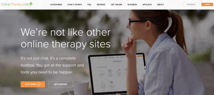 This screenshot of the home page for Online Therapy contains a filtered photo of a sideview of a smiling woman in glasses and a ponytail looking away from her open computer screen, along with white text that reads