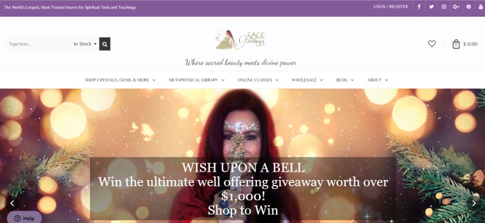 This screenshot of the home page for Sage Goddess has a purple header, a white navigation bar and a large picture of a smiling dark-haired woman with clear jewels on her forehead, holding what looks like a white baton with a metal star on top of it, behind a darker filtered text box with white lettering inviting browsers to shop and enter a giveaway contest.