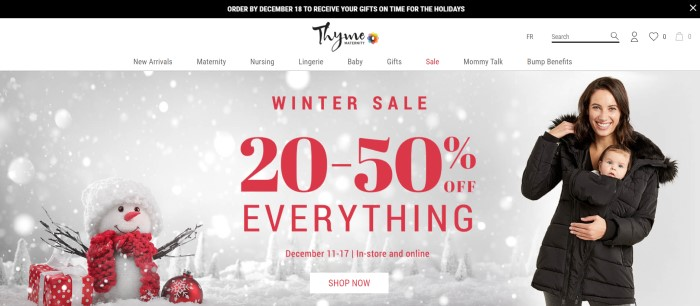 This screenshot of the home page for Thyme Maternity has a black header, a white navigation bar, and a photo of a smiling brown-haired woman with a baby, both wrapped inside a brown coat, standing near a snowman with a red scarf and surrounded by presents and ornaments, along with a winter sale announcement in red text.