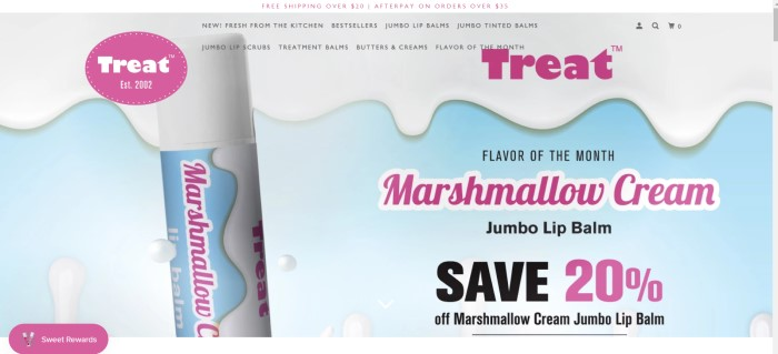This screenshot of the home page for Treat Beauty has a blue and white background that looks like melting marshmallow behind a photo of a Marshmallow Cream jumbo lip balm and purple text announcing Marshmallow Cream as the flavor of the month.