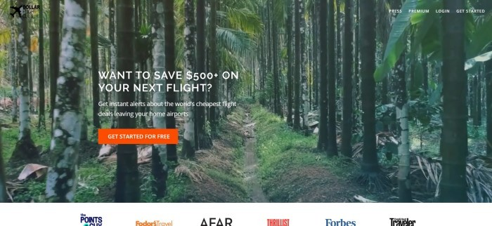 This screenshot of the home page for Dollar Flight Club shows a large photo of a trail in a jungle forest, along with white lettering reading
