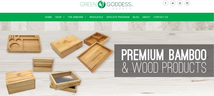This screenshot of the home page for Green Goddess supply has a white header with a green logo, a green navigation bar, and a photo of several wooden boxes and trays, along with a darker filtered text area with white text announcing premium bamboo products.