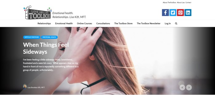 """This screenshot of the home page for Love And Life Toolbox has a white header and navigation bar above a photo of a side view of a woman running her fingers through her hair, along with white text that reads """"When things feel sideways"""" and two blue call-to-action buttons."""