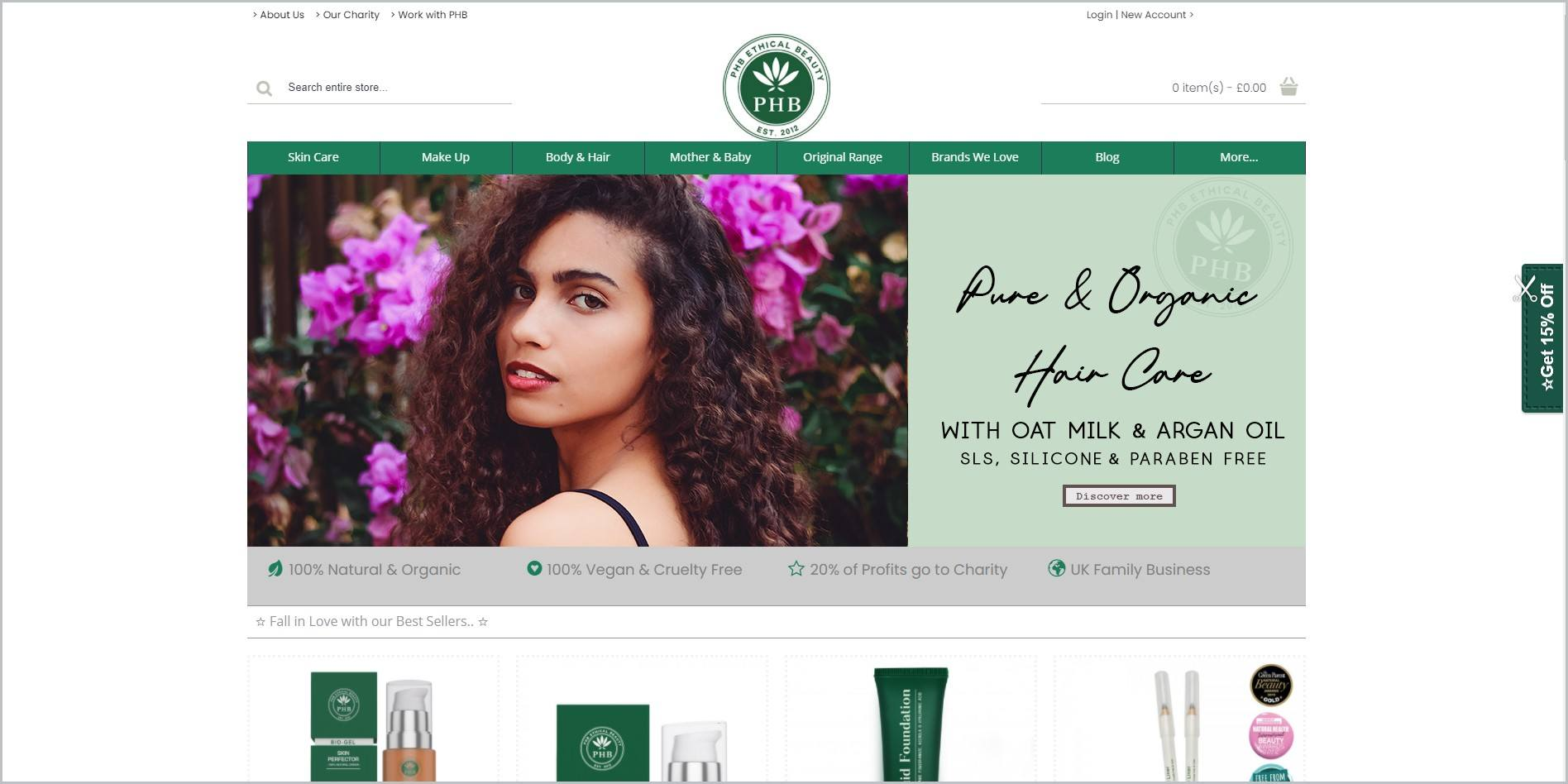 screenshot of PHB Ethical Beauty homepage, with white header with the website's name and logo, underneath it is the green main navigation bar, it also showcases an image of a woman as well as some of the website's products