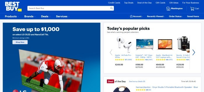 This screenshot of the home page for BestBuy has a royal blue and white header and navigation bar above a divided main section, with a sales announcement for TVs in a blue box on the left side of the page and a row of popular items in a white box on the right side of the page.