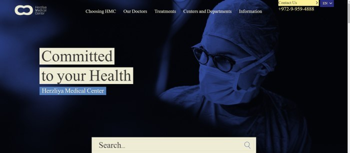 """This screenshot of Herzliya Medical Center has pale yellow text and elements on a dark blue filtered photo showing a woman medical professional in a cap, face mask, and glasses, along with text that reads """"Committed to your health."""""""