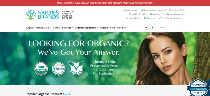 This screenshot of the home page for Nature's Brands has a red header, a white navigation bar, and a large photo showing a blurry green background with the face of a dark-haired woman peeking in from the right side of the page, along with text announcing popular organic products.