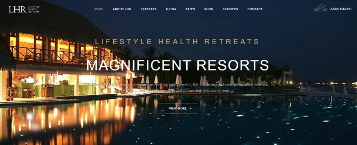 This screenshot of Lifestyle Health Retreats has a transparent navigation bar with white text overlaying a night photo of a brightly lit lakeside resort, including tan and white text announcing Lifestyle Health Retreats resorts.