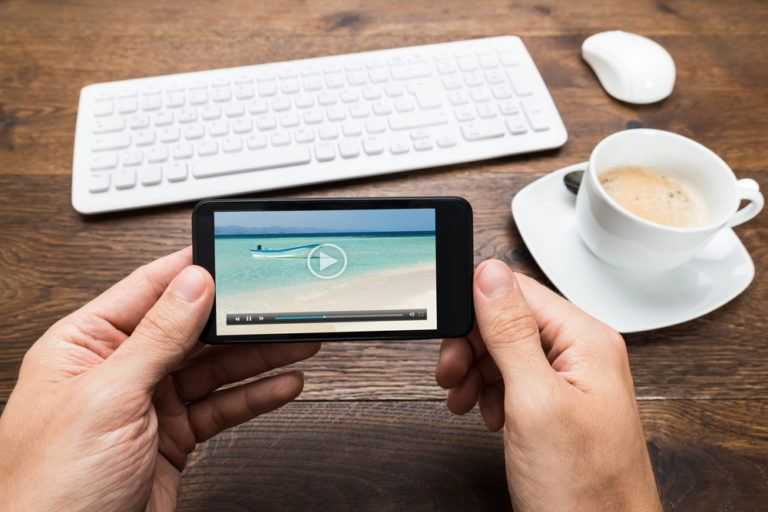 Someone watching a video on their smartphone