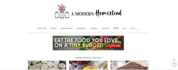 This screenshot of the home page for A Modern Homestead has a white navigation bar and background, with a photo of fresh vegetables behind an invitation to eat the food you love on a tiny budget and a row of photos showing homemade crackers, breads, and other goodies.