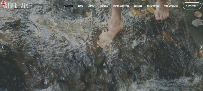 This screenshot of the home page for Ancestral Plants and Arthur Haines has a transparent navigation bar with white and black text over a photo of a man's feet wading barefoot in a stream.