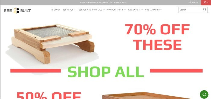 This screenshot of the home page for Bee Built has a gray header announcing free shipping and returns, a white navigation bar, and a white main section showing some wooden beekeeping equipment, along with red text announcing a 70% discount and a 50% discount.