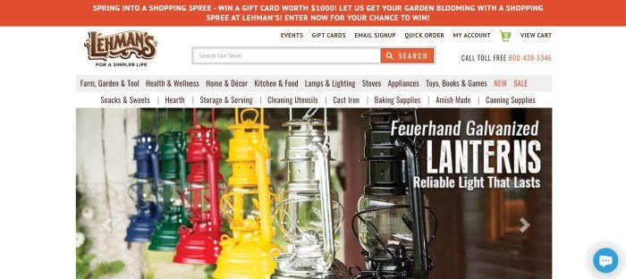 This screenshot of the home page for Lehman's has an orange header, a white and gray navigation bar, and a large photo showing a row of kerosene lanterns in green, blue, silver, yellow, red, and black, with white text announcing the lanterns.