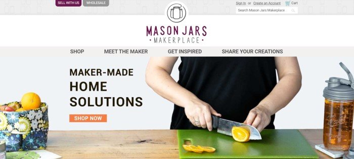 This screenshot of the home page for Mason Jars has a gray and white header, a gray navigation bar, and a photo of a woman in black cutting lemons on a green cutting board near a multicolored fabric basket holding fruit, along with black text announcing maker-made home solutions and an orange call-to-action button.