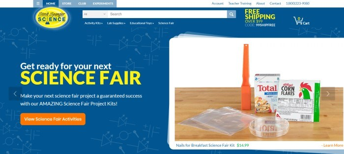 This screenshot of the home page for Steve Spangler Science has a blue background, white and yellow text, and a photo of a science fair kit containing a couple of boxes of cereal, along with an orange call-to-action button inviting customers to view science fair activities.