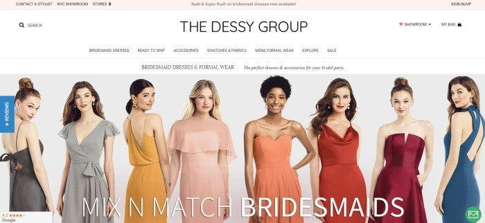 This screenshot for the home page of The Dessy Group has a pale pink header, a white navigation bar, and a photo of a row of women with various coloring and hairstyles wearing different styles of bridesmaid dresses in black, gray, gold, pink, coral, bright red, maroon, and teal.