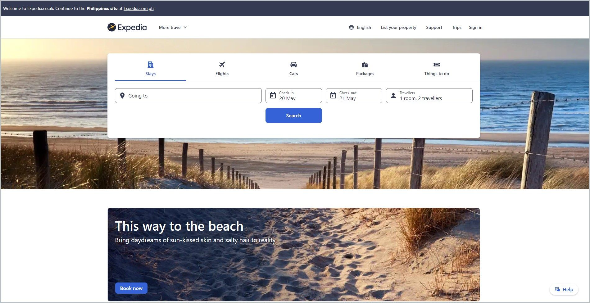 screenshot of Expedia UK homepage, with black announcement bar, and white header with the website's name and main navigation menu