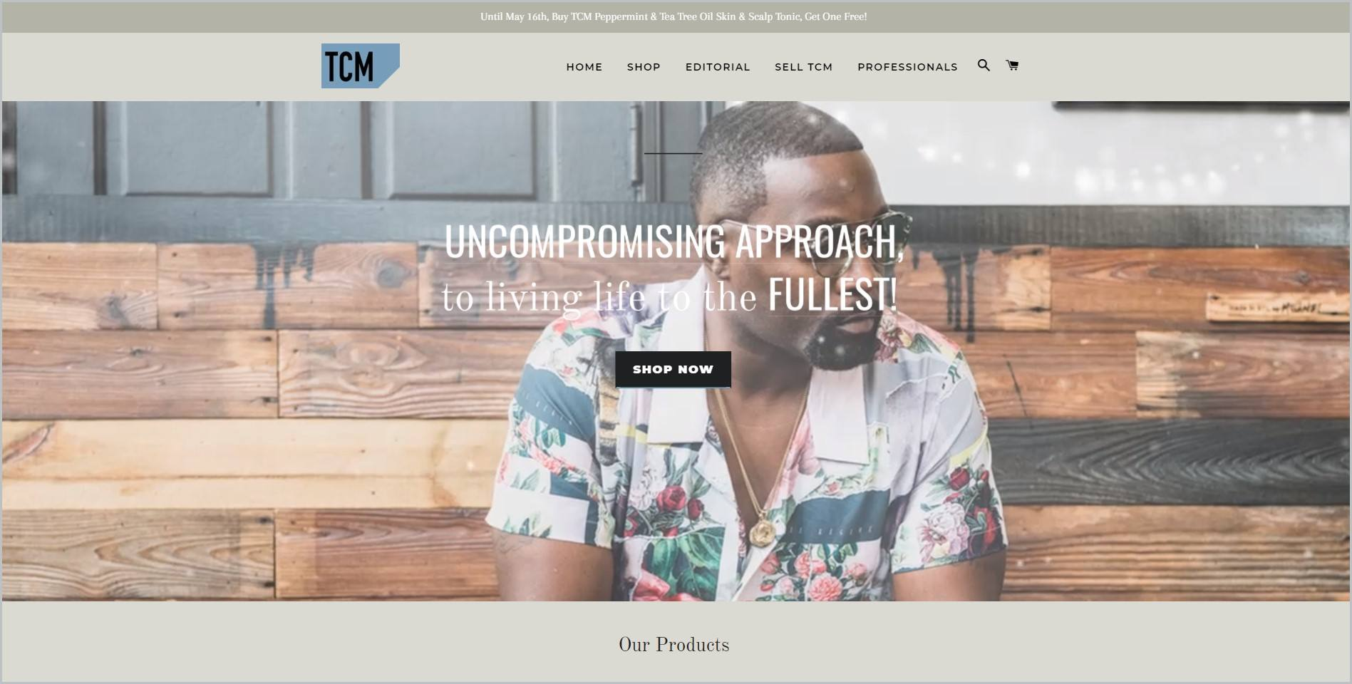 screenshot of TCM Lifestyle homepage showcasing an image of a freshly groomed black man in printed polo shirt