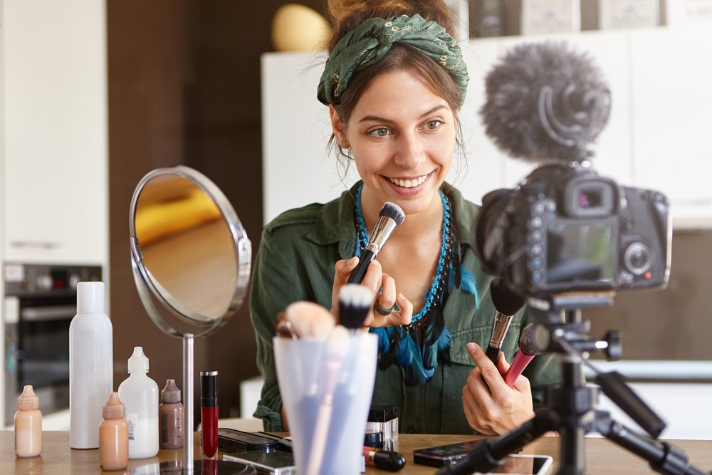 beauty blogger without makeup doing DSLR tutorial with directional mic
