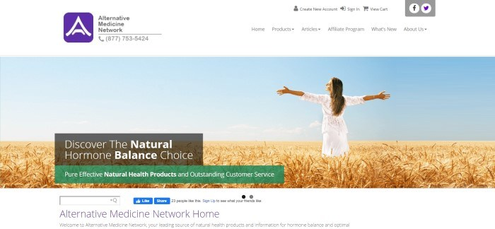 This screenshot of the home page for Alternative Medicine Network has a white header and navigation bar above a photo of a woman in a white dress, standing in a wheat field with her eyes closed and her face turned upward toward a blue sky, along with a small charcoal and green window announcing natural hormone balance options.
