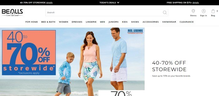 This screenshot of the home page for Bealls Florida has a black header, a white navigation bar, and a photo of a smiling man, woman, and boy in pink, blue, and white summer clothing playing on a beach, along with a sales announcement in pink and blue and another sales announcement with a white background.
