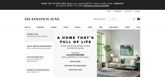This screenshot of the home page for Hudson's Bay has a black header, a white navigation bar, and a white background with gray and white windows containing text describing Spring products, as well as a photo on the right side of the page showing a room decorated in light green, gray, gold, white, and red.
