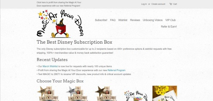 This screenshot of the home page for Magic At Your Door has a gray background and black text describing Disney subscription boxes, along with a large logo of a red box with yellow shoes, white gloves, and a black hat with yellow stars and a moon on it, which is near the top of the page, and a row of images showing different levels of subscription boxes along the bottom of the page.