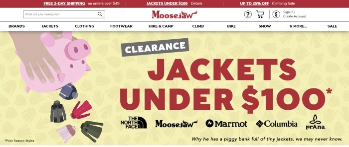 This screenshot of the home page for Moosejaw has a red header announcing free shipping and sales, a white navigation bar with a search bar, and a graphic with a yellow background and hands shaking a pink piggy-bank upside down while multicolored jackets fall out of it, next to red text announcing a jacket clearance sale.