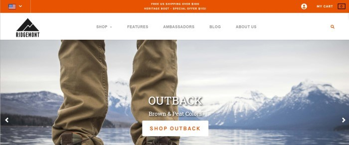 This screenshot of the home page for Ridgemont Outfitters has an orange header announcing free shipping, a white navigation bar, and a photo of a man's legs in hiking gear standing on the shore of a lake near some white-capped mountains, along with a white and orange call-to-action button.