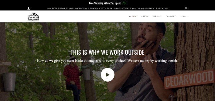 This screenshot of the home page for Rocky Mountain Barber Company has a dark header with white text announcing free shipping and free samples, a white navigation bar, and a still shot from a video with two bearded men in the woods, along with white text introducing the video and explaining that this company sends free gifts with every order.