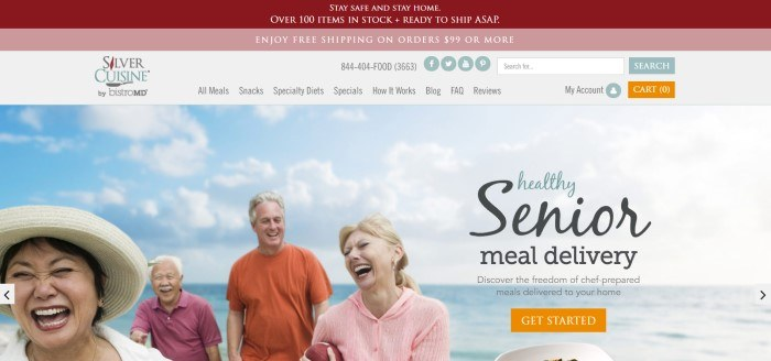 This screenshot of the home page for Silver Cuisine has a burgundy header, a pink secondary header announcing free shipping, a white navigation bar, and a photo of four aging men and women laughing as they play on a beach with blue skies, along with an invitation to order healthy meals for seniors and an orange call to action button.