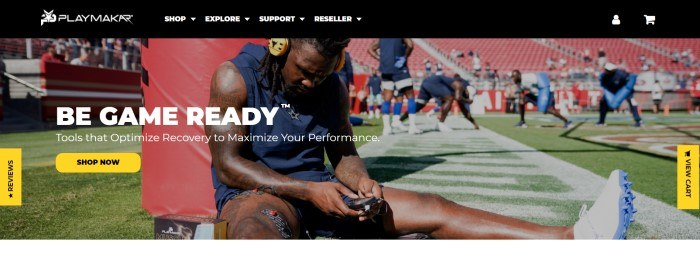 This screenshot of the home page for PlayMakar has a black navigation bar above a photo of a football player in a blue uniform sitting on a football field using PlayMakar devices while teammates practice in the background, along with white text inviting customers to be game-ready and a yellow call to action button.