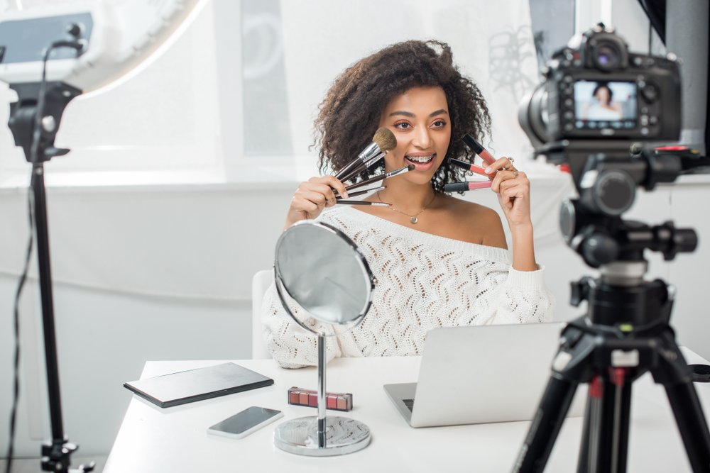 african american beauty blogger recording video