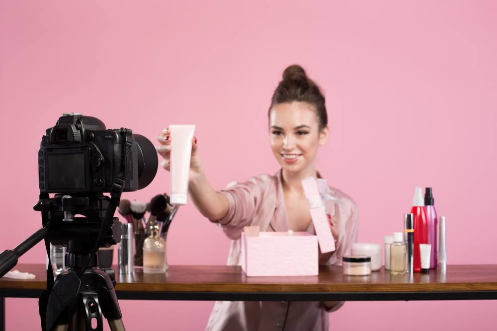 beauty blogger recording video advertising cosmetics products