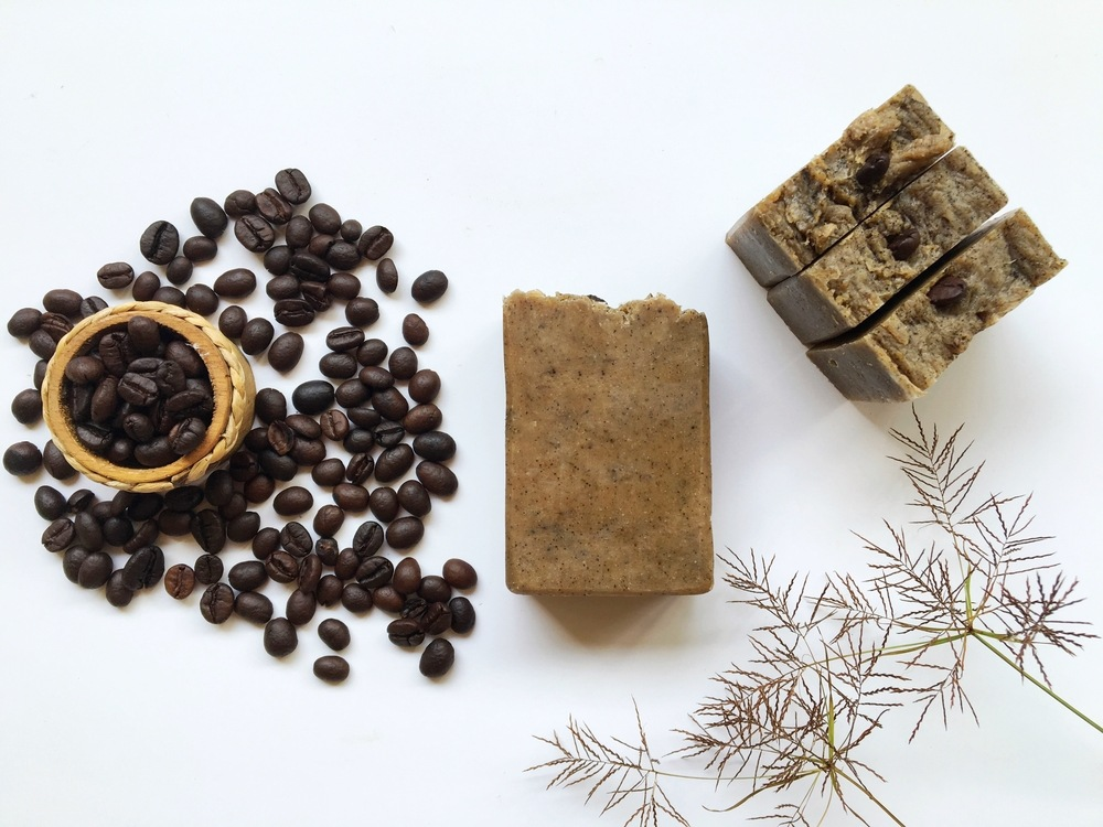 coffee scrub homemade soap with roasted coffee beans on white background
