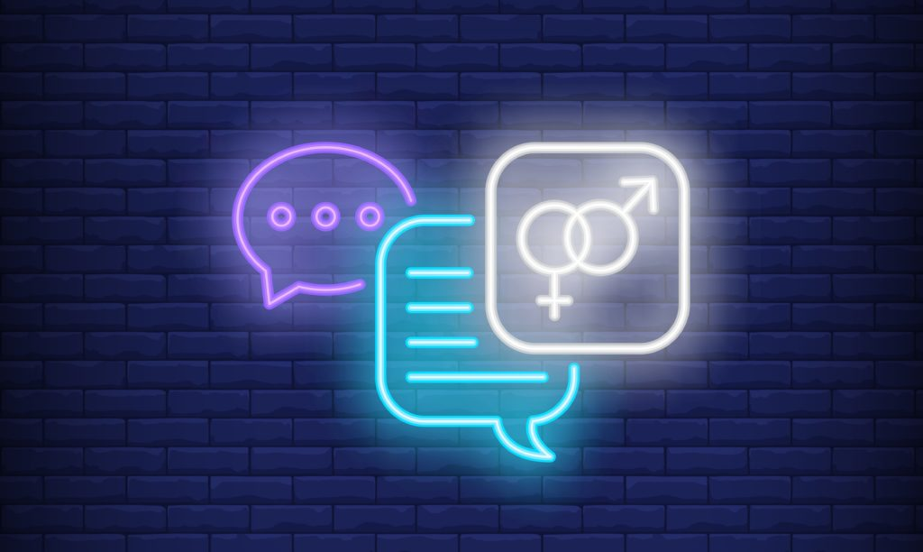 man woman text concept in neon sign with blue brick wall