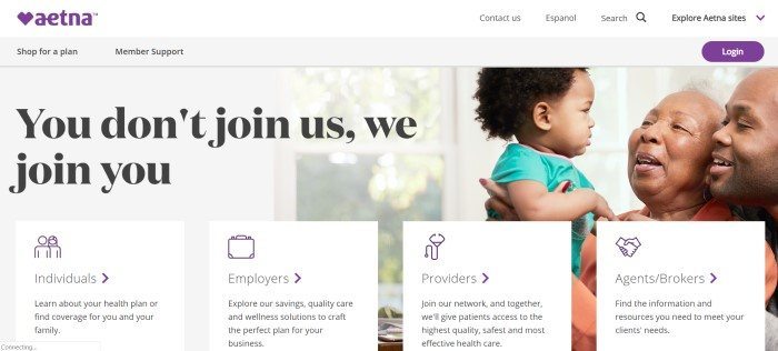 This screenshot of the home page for Aetna has a white navigation bar above a photo of a smiling, dark-skinned elderly woman holding a toddler with black, curly hair while a dark-skinned man leans over the woman's shoulder, smiling, along with links for different types of customers to find out more information.