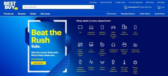 This screenshot of the home page for Best Buy has a royal blue background with text in white and yellow, along with several white-outlined icons for Best Buy departments such as laptops, TVs, video game controllers, and more, and an advertisement in yellow text to beat the Black Friday rush.